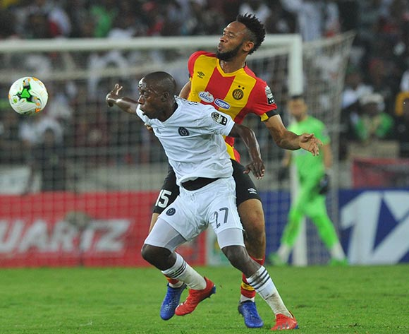 Fousseny Coulibaly of Esperance challenged by Ben Motshwari of Orlando Pirates during the CAF Champions League match between Orlando Pirates and Esperance 02 February 2019 at Orlando Stadium  Pic Sydney Mahlangu/ BackpagePix