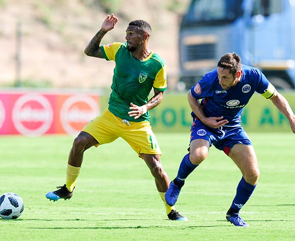 Wayde Jooste of Lamontville Golden Arrows comes away with the ball from the challenge of Dean Furman, Captain of Supersport United during the Absa Premiership 2018/19 game between Golden Arrows and SuperSport United at Sugar Ray Xulu Stadium in Durban the on 10 February 2019 © Gerhard Duraan/BackpagePix