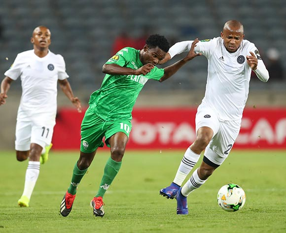 Ali Sadiki of Platinum challenged by Luvuyo Memela(L) and Xola Mlambo(R) of Orlando Pirates during the CAF Champions League match between Orlando Pirates and Platinum at Orlando Stadium, Johannesburg on 08 March 2019 ©Samuel Shivambu/BackpagePix