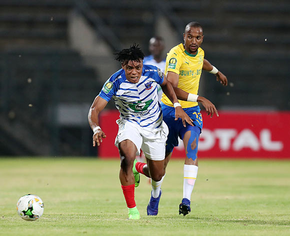 Kadri Timileyin of Lobi Stars challenged by Tiyani Mabunda of Mamelodi Sundowns during the 2019 TOTAL CAF Champions League match between Mamelodi Sundowns and Lobi Stars at the Lucas Moripe Stadium, Atteridgeville on the 09 March 2019 ©Muzi Ntombela/BackpagePix