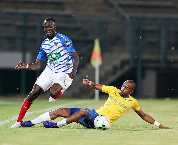 Yaya Kone of Lobi Stars tackled by Tiyani Mabunda of Mamelodi Sundowns during the 2019 TOTAL CAF Champions League match between Mamelodi Sundowns and Lobi Stars at the Lucas Moripe Stadium, Atteridgeville on the 09 March 2019 ©Muzi Ntombela/BackpagePix