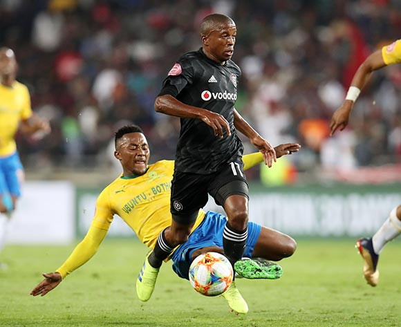 Luvuyo Memela of Orlando Pirates tackled by Lebohang Maboe of Mamelodi Sundowns during the Absa Premiership 2018/19 match between Orlando Pirates and Mamelodi Sundowns at the Orlando Stadium, Soweto on the 01 April 2019 ©Muzi Ntombela/BackpagePix