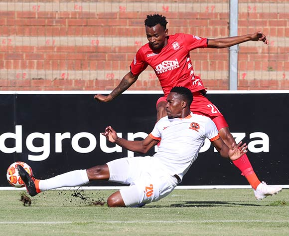 Luckyboy Mokoena of Highlands Park tackled by Ayanda Nkili of Polokwane City during the Absa Premiership 2018/19 match between Highlands Park and Polokwane City at Makhulong Stadium, Johannesburg on 27 April 2019 ©Samuel Shivambu/BackpagePix