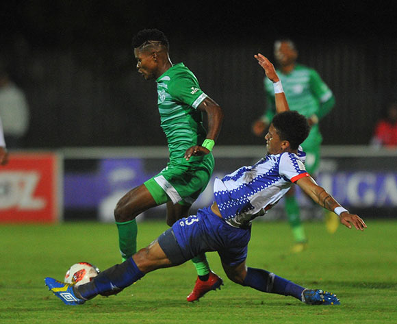 Menzi Masuku of Bloemfontein Celtic is challenged by Rushine De Reuck of Maritzburg United  during the Absa Premiership match between Maritzburg United and Bloemfontein Celtic on the 05 April 2019 at Harry Gwala Stadium  Pic Sydney Mahlangu/ BackpagePix
