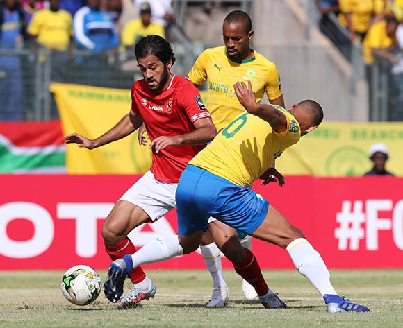 Mohsen Marwan of Al Ahly tackled by Wayne Arendse of Sundowns during the 2018/19 CAF Champions League football match between Sundowns and Al Ahly  at Lucas Moripe Stadium, Pretoria on 06 April 2019 ©Gavin Barker/BackpagePix
