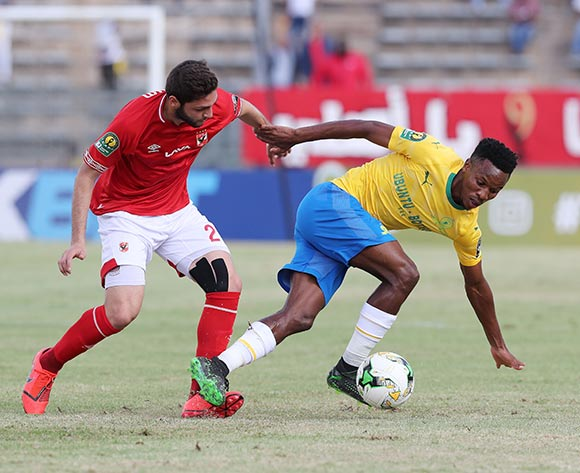 Themba Zwane of Sundowns tackled by Hassan Karim of Al Ahly during the 2018/19 CAF Champions League football match between Sundowns and Al Ahly  at Lucas Moripe Stadium, Pretoria on 06 April 2019 ©Gavin Barker/BackpagePix