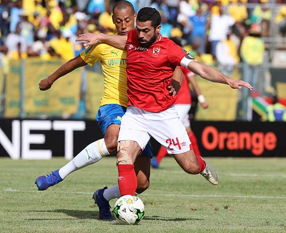 Ahmed Fathi of Al Ahly tackled by Wayne Arendse of Sundowns during the 2018/19 CAF Champions League football match between Sundowns and Al Ahly  at Lucas Moripe Stadium, Pretoria on 06 April 2019 ©Gavin Barker/BackpagePix