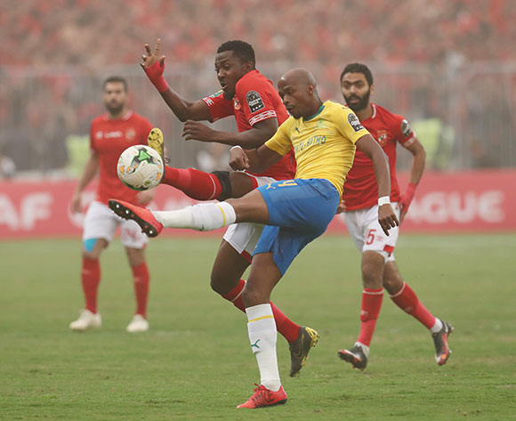 Tebogo Langerman of Sundowns clears ball from Oluwafemi Junior Ajayi of Al Ahly during the 2018/19 CAF Champions League football match between Al Ahly and Sundowns at Borg El Arab, Alexandia, Egypt on 13 April 2019 ©Gavin Barker/BackpagePix