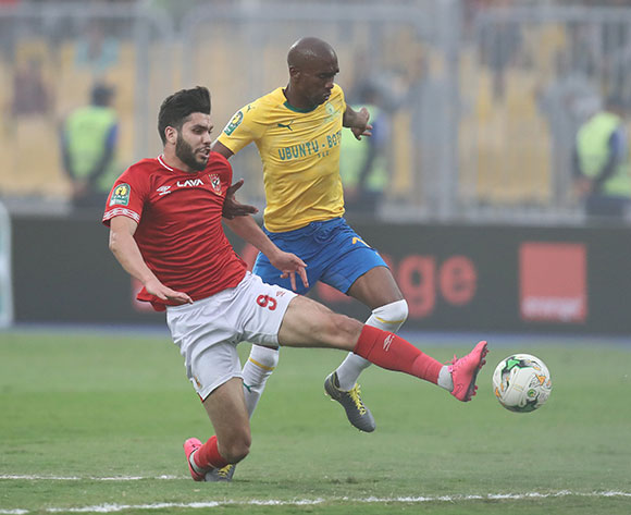 Oualid Azaro of Al Ahly challenged by Anele Ngcongca of Sundowns during the 2018/19 CAF Champions League football match between Al Ahly and Sundowns at Borg El Arab, Alexandia, Egypt on 13 April 2019 ©Gavin Barker/BackpagePix