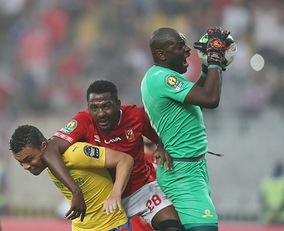 Denis Onyango of Sundowns saves from Oluwafemi Junior Ajayi of Al Ahly during the 2018/19 CAF Champions League football match between Al Ahly and Sundowns at Borg El Arab, Alexandia, Egypt on 13 April 2019 ©Gavin Barker/BackpagePix
