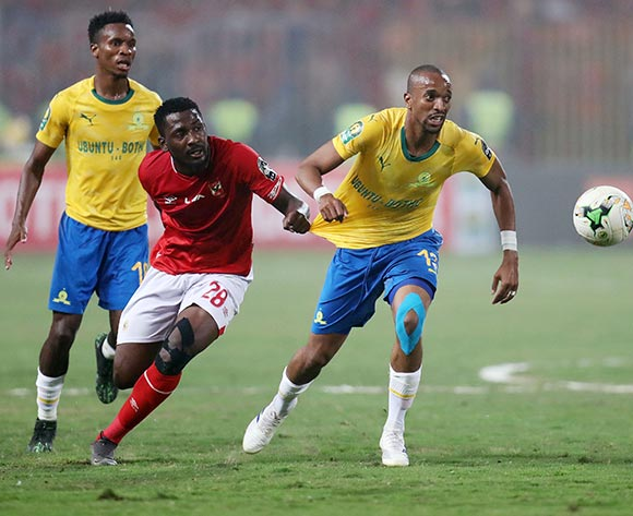 Tiyani Mabunda of Sundowns pulled back by Oluwafemi Junior Ajayi of Al Ahly  during the 2018/19 CAF Champions League football match between Al Ahly and Sundowns at Borg El Arab, Alexandia, Egypt on 13 April 2019 ©Gavin Barker/BackpagePix