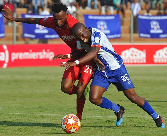 Luckyboy Mokoena of Highlands Park challenges Mxolisi Kunene of Maritzburg Uinted during the Absa Premiership match between Highlands Park and  Maritzburg United on the 13 April 2019 at Makhulong Stadium Pic Sydney Mahlangu/ BackpagePix