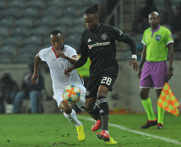 Mthokozisi Dube of Orlando Pirates challenged by Sifiso Mbhele of Free State Stars during the Absa Premiership match between Orlando Pirates and Free State Stars on the 13 April 2019 at Orlando Stadium Pic Sydney Mahlangu/ BackpagePix