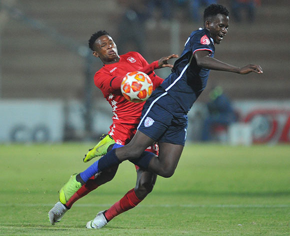 Sibusiso Hlubi of Free State Stars challenges Lesenya Ramoraka of Highlands Park during the Absa Premiership match between Highlands Park and Free State Stars on the 17 April 2019 at Makhulong Stadium Pic Sydney Mahlangu/ BackpagePix