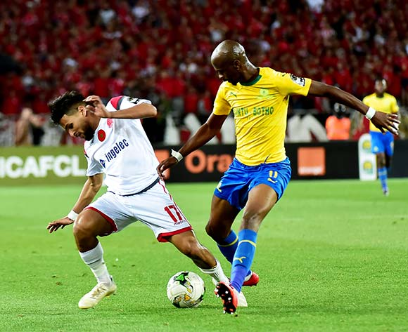 Badi Aouk of Wydad Athletic Club is challenged by Tebogo Langerman of Mamelodi Sundowns during the 2019 TOTAL CAF Champions League match between Mamelodi Sundowns and Wydad Athletic Club at Prince Moulay Abdellah Stadium in Rabat, Morocco, 26 April 2019. EPA/STR