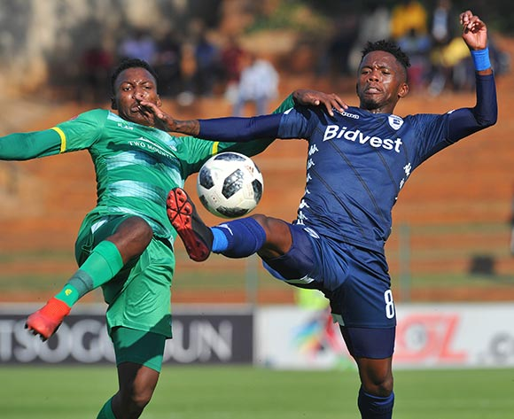 Thabang Monare of Bidvest Wits is challenged by Thato Madigoe of Baroka FC during the Absa Premiership match between Bidvest Wits and Baroka FC on the 4 of May 2019 at Bidvest Stadium Pic Sydney Mahlangu/ BackpagePix