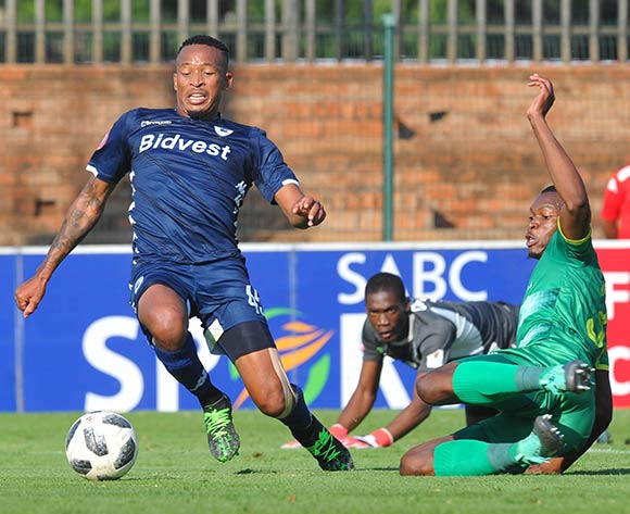 Lehlohonolo Majoro of Bidvest Wits scores ahead of Vusi Sibiya of Baroka FC during the Absa Premiership match between Bidvest Wits and Baroka FC on the 4 of May 2019 at Bidvest Stadium Pic Sydney Mahlangu/ BackpagePix
