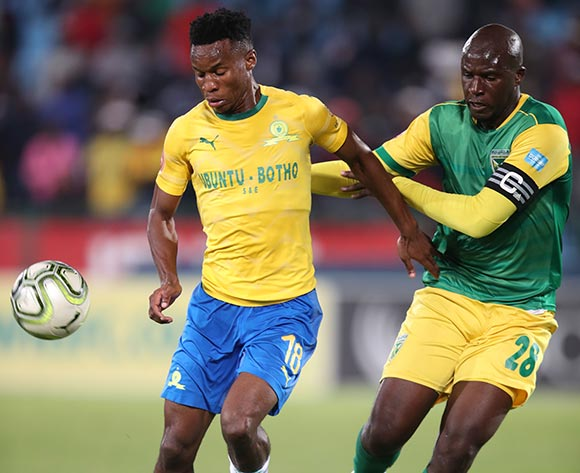 Themba Zwane of Mamelodi Sundowns challenged by Musa Bilankulu of Golden Arrows during the Absa Premiership 2018/19 match between Mamelodi Sundowns and Golden Arrows at Loftus Versfeld Stadium, Pretoria on 07 May 2019 ©Samuel Shivambu/BackpagePix