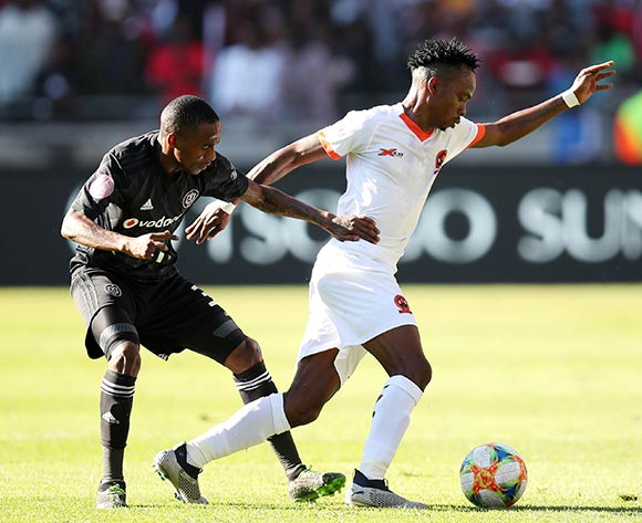 Mpho Mvelase of polokwane City challenged by Thembinkosi Lorch of Orlando Pirates during the Absa Premiership 2018/19 match between Orlando Pirates and Polokwane City at the Orlando Stadium, Soweto on the 11 May 2019 ©Muzi Ntombela/BackpagePix