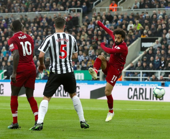 Mohamed Salah score as Liverpool go top