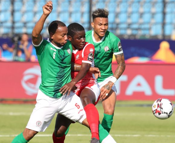 Shassiri Nahimana of Burundi challenged by Marco Ilaiharitra (l) and Anicet Andrianantenaina of Madagascar during the 2019 Africa Cup of Nations match between Madagascar and Burundi at the Alexandria Stadium, Alexandria on the 27 June 2019 ©Muzi Ntombela/BackpagePix