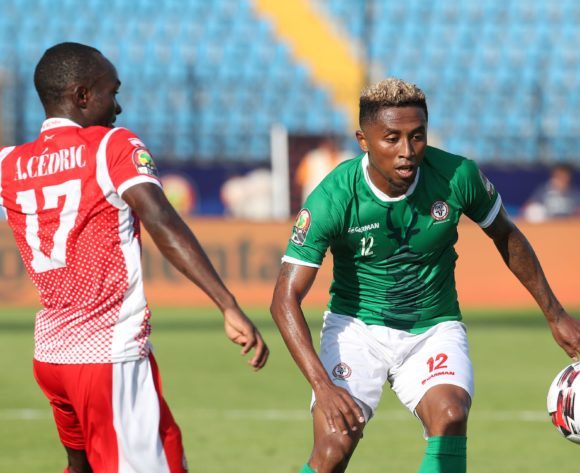 Lalaina Henintsoa Enjanahary of Madagascar challenged by Amissi Cedric of Burundi during the 2019 Africa Cup of Nations match between Madagascar and Burundi at the Alexandria Stadium, Alexandria on the 27 June 2019 ©Muzi Ntombela/BackpagePix