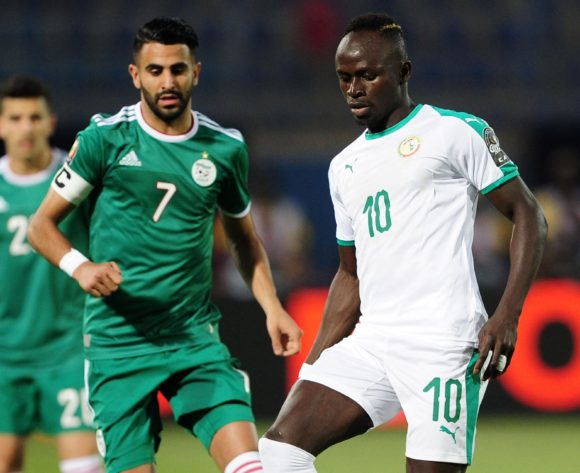 Sadio Mane of Senegal controls ahead of Riyad Mahrez of Algeria during the 2019 Africa Cup of Nations Finals match between Senegal and Algeria at 30 June Stadium, Cairo, Egypt on 27 June 2019 © Ryan Wilkisky/BackpagePix