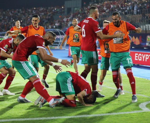Morocco players surround Youssef En-Nesyri (on ground) after scoring goal during the 2019 Africa Cup of Nations Finals football match between Morocco and Ivory Coast at the Al Salam Stadium, Cairo, Egypt on 28 June 2019 ©Gavin Barker/BackpagePix