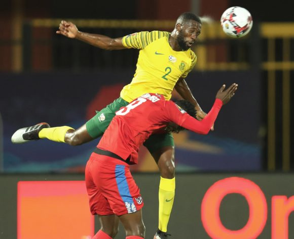Buhle Mkhwanazi of South Africa wins header against Benson Shilongo of Namibia during the 2019 Africa Cup of Nations Finals football match between South Africa and Namibia at the Al Salam Stadium, Cairo, Egypt on 28 June 2019 ©Gavin Barker/BackpagePix