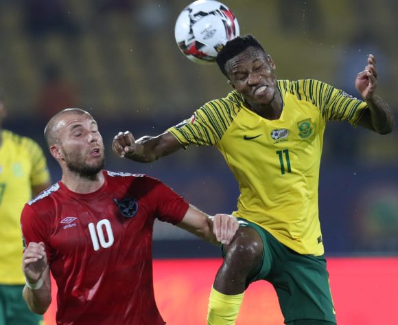 Themba Zwane of South Africa wins header against Manfred Starke of Namibia during the 2019 Africa Cup of Nations Finals football match between South Africa and Namibia at the Al Salam Stadium, Cairo, Egypt on 28 June 2019 ©Gavin Barker/BackpagePix