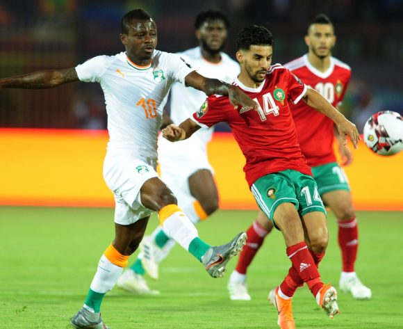 M'bark Boussoufa of Morocco is challenged by Jean Michael Seri of Ivory Coast during the 2019 Africa Cup of Nations Finals match between Morocco and Ivory Coast at Al Salam Stadium in Cairo, Egypt on 28 June 2019 © Ryan Wilkisky/BackpagePix