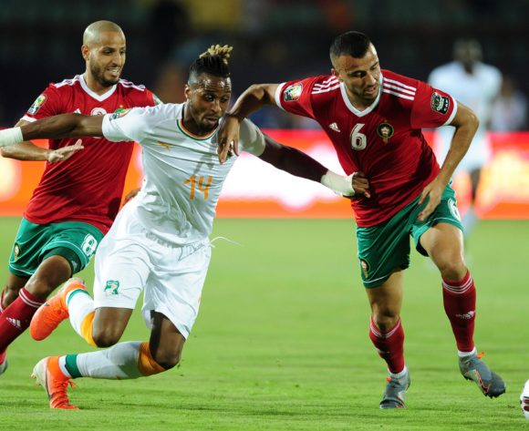 Jonathan Kodjia of Ivory Coast is challenged by Ghanem Saiss of Morocco during the 2019 Africa Cup of Nations Finals match between Morocco and Ivory Coast at Al Salam Stadium in Cairo, Egypt on 28 June 2019 © Ryan Wilkisky/BackpagePix