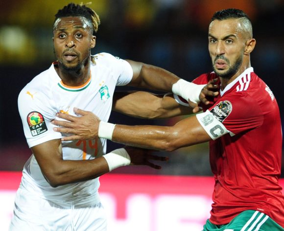 Jonathan Kodjia of Ivory Coast is closely marked by Mehdi Benatia of Morocco  during the 2019 Africa Cup of Nations Finals match between Morocco and Ivory Coast at Al Salam Stadium in Cairo, Egypt on 28 June 2019 © Ryan Wilkisky/BackpagePix
