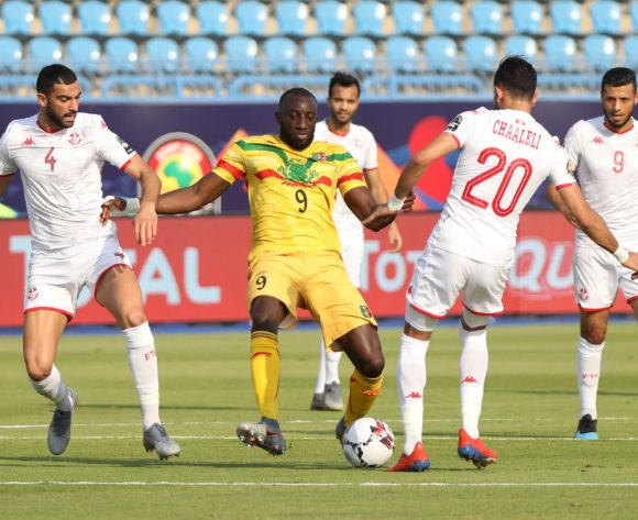 Moussa Marega of Mali challenged by Yassine Merriah and Ghaylen Chaaleli of Tunisia during the 2019 Africa Cup of Nations Finals match between Tunisia and Mali at Suez Stadium, Suez, Egypt on 28 June 2019 ©Samuel Shivambu/BackpagePix