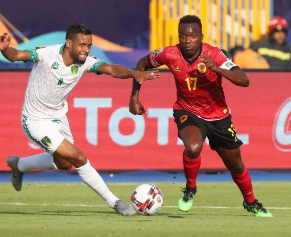 Mateus Galiano of Angola challenged by Khalil Moulaye Ahmed Bessam of Mauritania during the 2019 Africa Cup of Nations Finals football match between Mauritania and Angola  at the Suez Stadium, Suez, Egypt on 29 June 2019 ©Gavin Barker/BackpagePix