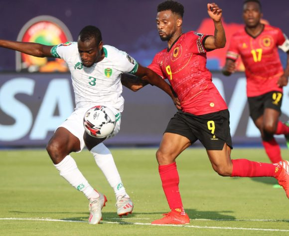 Alfredo Ribeiro Fredy of Angola challenges Aly Abeid of Mauritania during the 2019 Africa Cup of Nations Finals football match between Mauritania and Angola  at the Suez Stadium, Suez, Egypt on 29 June 2019 ©Gavin Barker/BackpagePix