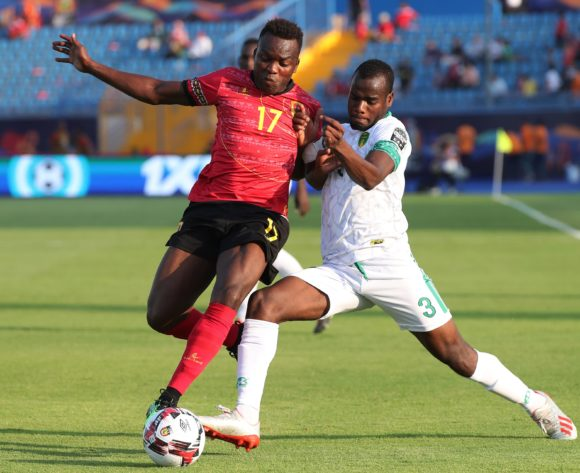 Mateus Galiano of Angola challenged by Aly Abeid of Mauritania during the 2019 Africa Cup of Nations Finals football match between Mauritania and Angola  at the Suez Stadium, Suez, Egypt on 29 June 2019 ©Gavin Barker/BackpagePix