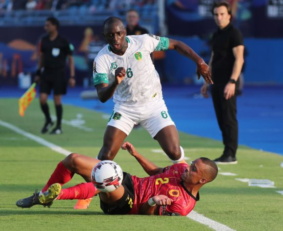 Khassa Camara of Mauritania tackled by Bruno Gaspar of Angola during the 2019 Africa Cup of Nations Finals football match between Mauritania and Angola  at the Suez Stadium, Suez, Egypt on 29 June 2019 ©Gavin Barker/BackpagePix