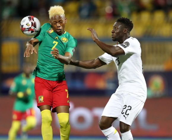 Clinton Njie of Cameroon challenged by Andrew Kyere Yiadom of Ghana during the 2019 Africa Cup of Nations Finals Cameroon and Ghana at Ismailia Stadium, Ismailia, Egypt on 29 June 2019 ©Samuel Shivambu/BackpagePix