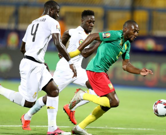 Karl Toko Ekambi of Cameroon challenged by Jonathan Mensah and Andrew Kyere Yiadom of Ghana during the 2019 Africa Cup of Nations Finals Cameroon and Ghana at Ismailia Stadium, Ismailia, Egypt on 29 June 2019 ©Samuel Shivambu/BackpagePix