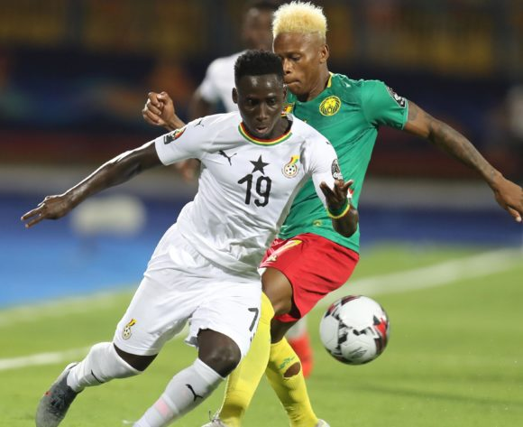 Samuel Owusu of Ghana challenged by Clinton Njie of Cameroon during the 2019 Africa Cup of Nations Finals Cameroon and Ghana at Ismailia Stadium, Ismailia, Egypt on 29 June 2019 ©Samuel Shivambu/BackpagePix