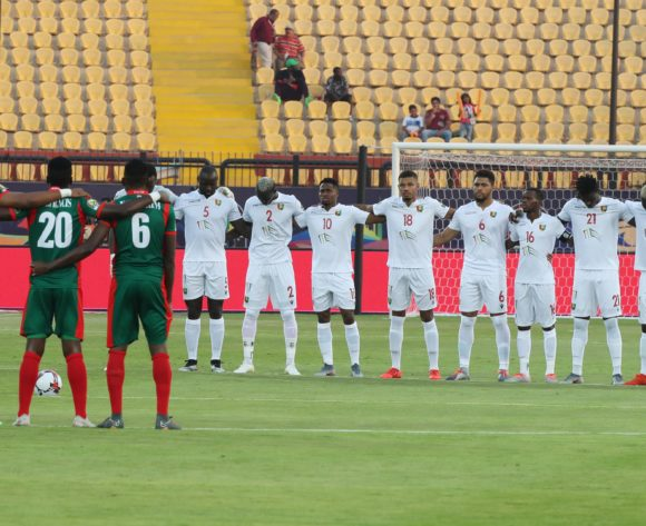 Guinea and Burundi players observe moment of silence for former DR Congo striker Pierre Ndaye Mulamba during the 2019 Africa Cup of Nations Finals football match between Burundi and Guinea at the Al Salam Stadium, Cairo, Egypt on 28 June 2019 ©Gavin Barker/BackpagePix