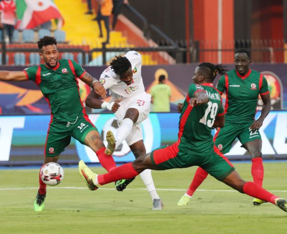 Sory Kaba of Guinea shoots, closed down by Omar Ngando (l)  and Nsabiyumva Frederic of Burundi during the 2019 Africa Cup of Nations Finals football match between Burundi and Guinea at the Al Salam Stadium, Cairo, Egypt on 28 June 2019 ©Gavin Barker/BackpagePix