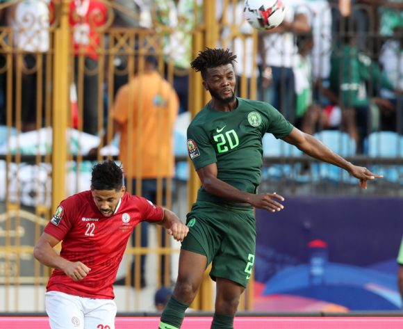 Collins Awaziem of Nigeria challenged by Jerome Mombris of Madagascar during the 2019 Africa Cup of Nations match between Madagascar and Nigeria at the Alexandria Stadium, Alexandria on the 30 June 2019 ©Muzi Ntombela/BackpagePix