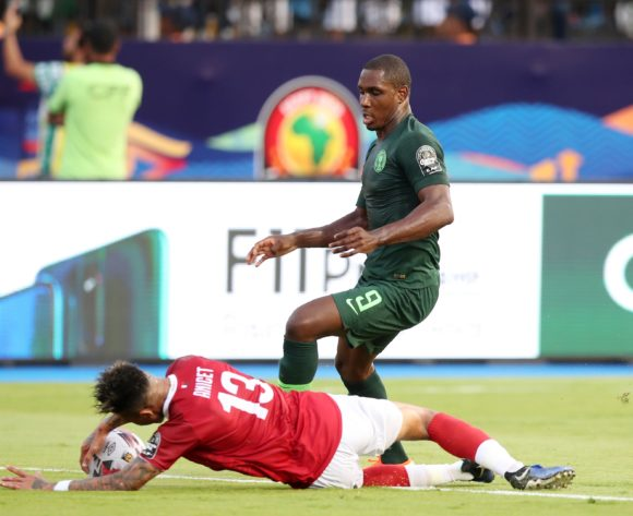 Anicet Andrianantenaina of Madagascar fouled by Odion Jude Ighalo of Nigeria during the 2019 Africa Cup of Nations match between Madagascar and Nigeria at the Alexandria Stadium, Alexandria on the 30 June 2019 ©Muzi Ntombela/BackpagePix