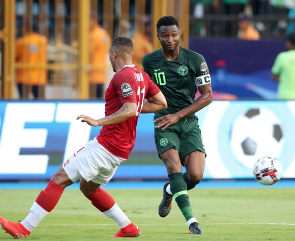 John Obi Mikel of Nigeria challenged by Thomas Fontaine of Madagascar during the 2019 Africa Cup of Nations match between Madagascar and Nigeria at the Alexandria Stadium, Alexandria on the 30 June 2019 ©Muzi Ntombela/BackpagePix
