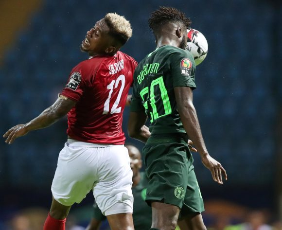 Collins Awaziem of Nigeria challenged by Lalaina Henintsoa Enjanahary of Madagascar during the 2019 Africa Cup of Nations match between Madagascar and Nigeria at the Alexandria Stadium, Alexandria on the 30 June 2019 ©Muzi Ntombela/BackpagePix