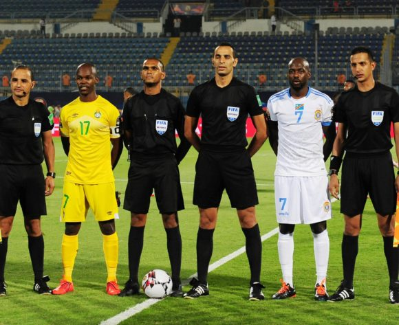 Knowledge Musona of Zimbabwe and Mulumbu Yousuf of DR Congo line up with match officials before the 2019 Africa Cup of Nations Finals game between Zimbabwe and DR Congo at 30 June Stadium in Cairo, Egypt on 30 June 2019 © Ryan Wilkisky/BackpagePix