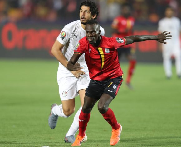 Emmanuel Okwi of Uganda challenged by .Ahmed Hegazi of Egypt during the 2019 Africa Cup of Nations Finals Uganda and Egypt at Cairo International Stadium, Cairo, Egypt on 30 June 2019 ©Samuel Shivambu/BackpagePix