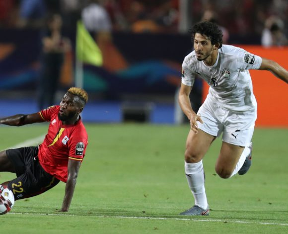 Abdu Lumala of Uganda challenged by Ahmed Hegazi of Egypt during the 2019 Africa Cup of Nations Finals Uganda and Egypt at Cairo International Stadium, Cairo, Egypt on 30 June 2019 ©Samuel Shivambu/BackpagePix